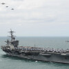 150322-N-ZF573-140 ATLANTIC OCEAN (March 22, 2015) Aircraft from Carrier Air Wing 1 fly in formation over the Nimitz-class aircraft carrier USS Theodore Roosevelt (CVN 71) during an airpower demonstration March 22, 2015. Theodore Roosevelt, homeported in Norfolk, is conducting naval operations in the U.S. 6th Fleet area of operations in support of U.S. national security interests in Europe. (U.S. Navy photo by Mass Communication Specialist 2nd Class Chris Brown/Released)