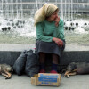 A woman beggs in the center of in Kiev, Ukraine 26 July 1994. Many people in Ukraine could not find their place in the new life after the changes, which took place in Ukraine during past years.EPA/SERGEI SUPINSKY
